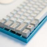 Custom keyboard with Zeal60, Zealiostotlespacers, Enjoy PBT Kana Keycaps, Sentraq Teal Plate and Case - Ryan MacLean