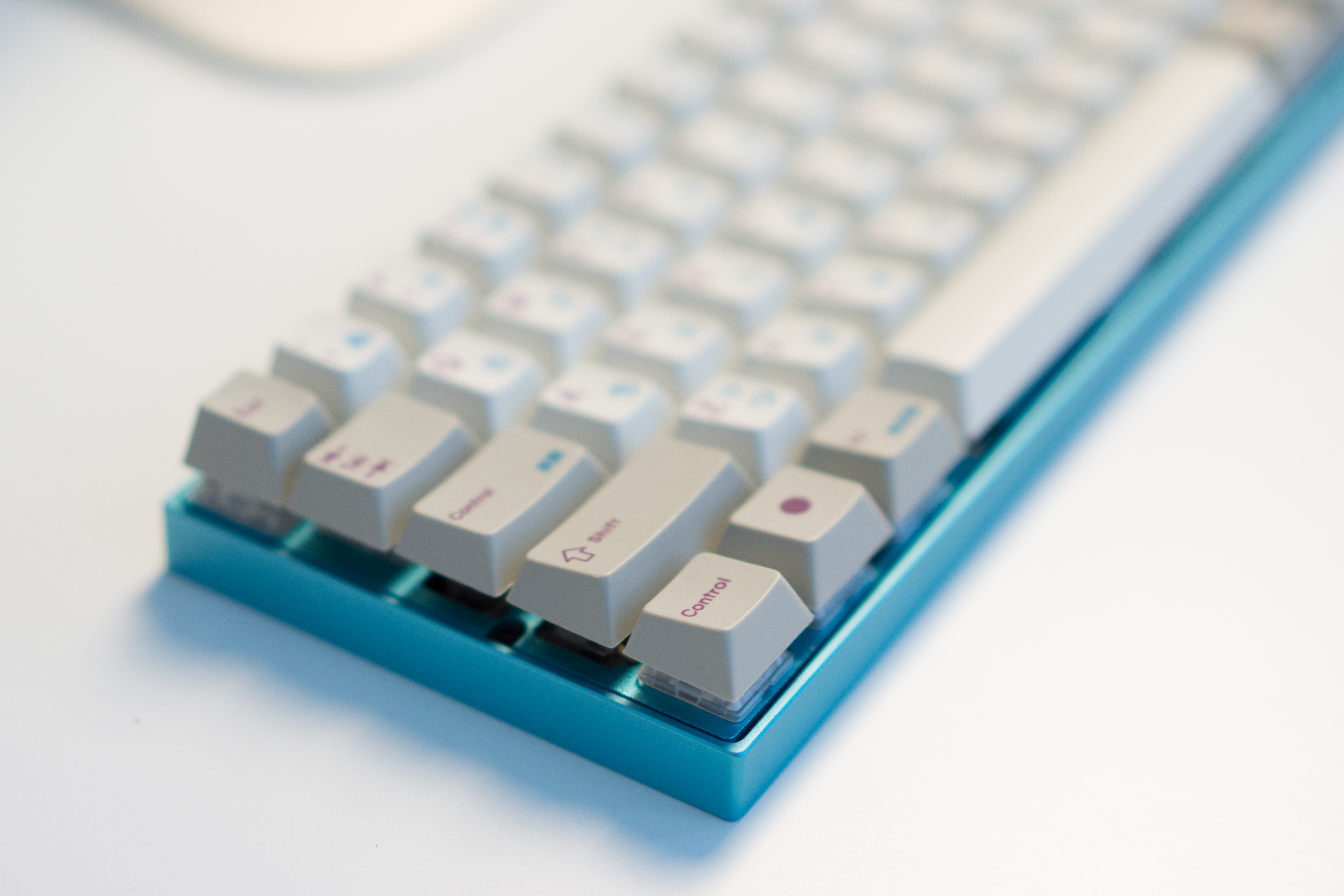 Custom keyboard with Zeal60, Zealiostotlespacers, Enjoy PBT Kana Keycaps, Sentraq Teal Plate and Case - Ryan MacLean